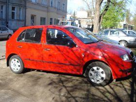 Skoda Fabia 1.2 l czerwony 5-drzwiowy benzyna 11900 PLN cena do negocjacji z autoalermem we Wrocławiu