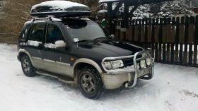 Kia Sportage sprzedam czarny benzyna + LPG z alufelgami 10000 PLN nieuszkodzony 5-drzwiowy w Konstancinie-Jeziornej