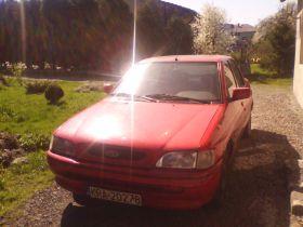 Ford Escort 1996 r Hatchback sprzedam czerwony przyciemniane szyby diesel z małym przebiegiem Wola Filipowska