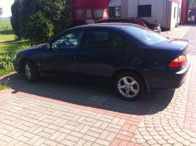 Toyota Avensis 2.0 l sprzedam granatowy alufelgi Welurowa 17900 PLN dodatkowy komplet opon Łódź