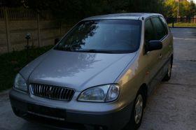 Kia Carens 1.8 l sprzedam beżowy 10200 PLN cena do negocjacji z małym przebiegiem benzyna + LPG ABS Tarczyn